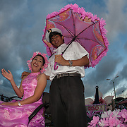 Couple on a float at Baywalk, the city promenade, at the end of the Balayong Festival parade. The festival at the beginning of March commemorates the founding anniversary of the City of Puerto Princesa, Palawan, highlighted by balayong tree-planting, street dancing and a colourful floral parade depicting the Palawan cherry blossoms from which the festival derives its name. The Palawan cherry is one of the most popular flowering trees in Palawan and known by the locals as the Balayong, a beautiful tree that when it is in full bloom resembles the cherry blossoms of Japan.