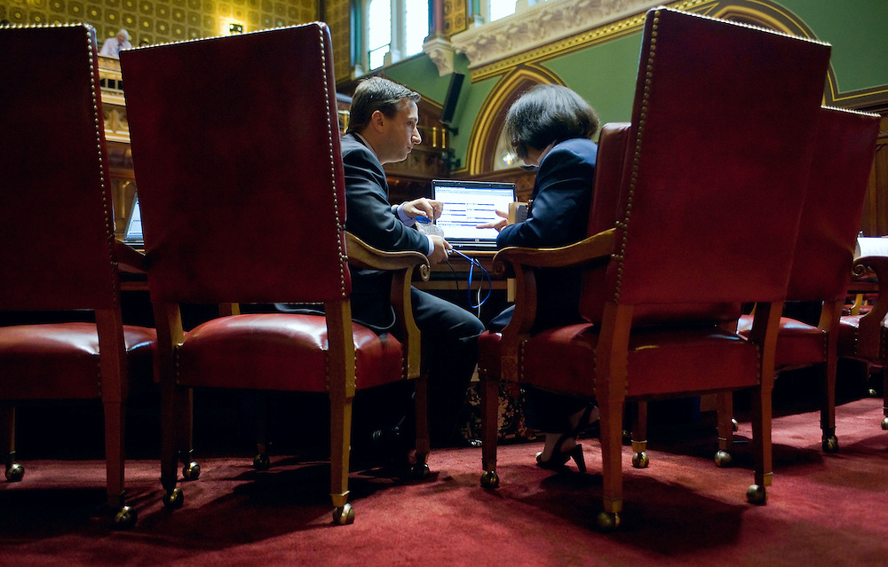 State Sen. Bob Duff, D-Norwalk, left, speaks with State Sen. Toni Boucher, R-Wilton during the last day of session for the Connecticut General Assembly at the Capitol in Hartford, Conn. The session resolved several high-profile, perennial issues including the state's death penalty, medical marijuana usage and Sunday alcohol sales.  (AP Photo/Jessica Hill)
