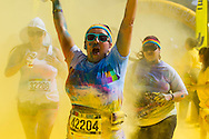 People take part in the Color Run on the Dodgers Stadium, Saturday, June 21, 2014 in Los Angeles, California. The Color Run is an event series and five kilometres paint race that takes place in North America, South America, Europe, Asia, and Australia. The untimed event has no winners or prizes, but runners are showered with colored powder at stations along the run.<br />  (Photo by Ringo Chiu/PHOTOFORMULA.com)