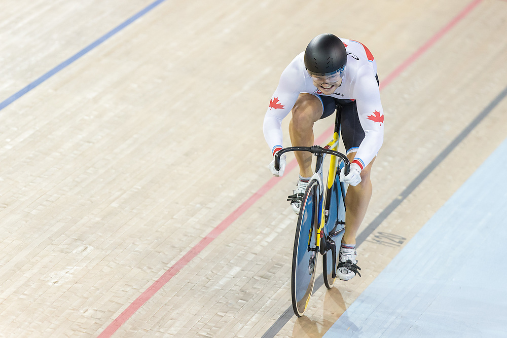 Hugo Barette of Canada races the final lap of the gold medal race against Venezuela in the men's team sprint at the 2015 Pan American Games in Toronto, Canada, July 16,  2015. Canada defeated Venezuela to take the gold medal. AFP PHOTO/GEOFF ROBINS
