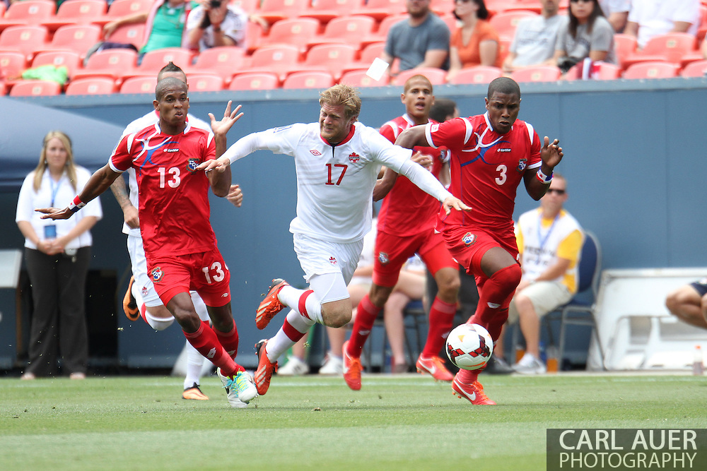 July 14 2013:  Canada Defender Marcel De Jong (17) is fouled by Panama Defender Jean Carlos Cedeño (13) during the first half of the CONCACAF Gold Cup soccer match between Panama and Canada at Sports Authority Field in Denver, CO. USA.