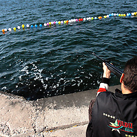 A man shoots an air rifle at balloons floating on Izmir Bay in Izmir, Turkey.