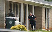 Tuscaloosa Police, Sheriff's Deputies and a composite tactical unit surround a home on 20th Ave. East after at least two people were shot at the residence Thursday, August 11, 2016.  Staff Photo/Gary Cosby Jr.
