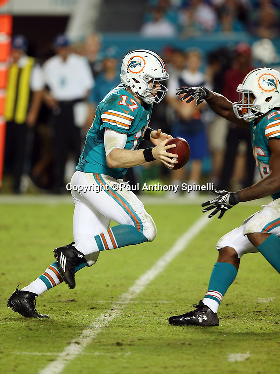 Miami Dolphins quarterback Ryan Tannehill (17) fakes a handoff as he drops back and throws a fourth quarter pass during the NFL week 14 regular season football game against the New York Giants on Monday, Dec. 14, 2015 in Miami Gardens, Fla. The Giants won the game 31-24. (©Paul Anthony Spinelli)