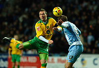 Photo: Daniel Hambury.<br /> Coventry City v Norwich City. Coca Cola Championship.<br /> 26/11/2005.<br /> Norwich's Dean Ashton and Coventry's Andy Hughes battle for the ball.