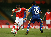 Photo: Rich Eaton.<br /> <br /> Wales v Cyprus. UEFA European Championships 2008 Qualifying. 11/10/2006. Simon Davies, left of Wales takes on Alexandros Garpozis