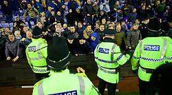 WIGAN, ENGLAND - Monday, February 19, 2018: Greater Manchester Police officers hold up weapons as they face off with Manchester City supporters after the club's 1-0 defeat during the FA Cup 5th Round match between Wigan Athletic FC and Manchester City FC at the DW Stadium. (Pic by David Rawcliffe/Propaganda)