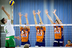 Dejan Pelemis of Panvita Pomgrad vs Gregor Ropret of ACH, Matej Vidic of ACH and Jan Klobucar of ACH during volleyball game between OK ACH Volley and OK Panvita Pomgrad in 1st final match of Slovenian National Championship 2013/14, on April 6, 2014 in Arena Tivoli, Ljubljana, Slovenia. Photo by Vid Ponikvar / Sportida