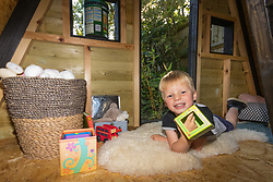 Dad of two Tom Prior has created a beautiful shingle clad, two floor play house in the garden of his Shoreham, West Sussex home for his children. Tom's son Jackson, 4, has plenty of space to play in the cosy A-framed shed. Shoreham, West Sussex, July 15 2019.