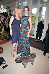 Left to right, SUSANNAH CONSTANTINE and TRINNY WOODALL with her pet dog at the annual Dog's Trust Honours Awards held at The Hurlingham Club, Fulham, London on 19th May 2009.