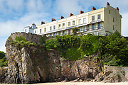 Esplanade - traditional brightly coloured seaside housing and tourist accommodation above clifftop in resort town of Tenby, Wales, UK