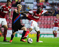 Bristol City's Marvin Elliott jostles for the ball with Crystal Palace's Jonathan Willams  - Photo mandatory by-line: Dougie Allward/JMP - Tel: Mobile: 07966 386802 27/08/2013 - SPORT - FOOTBALL - Ashton Gate - Bristol - Bristol City V Crystal Palace -  Capital One Cup - Round 2