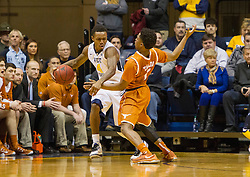 Jan 20, 2016; Morgantown, WV, USA; West Virginia Mountaineers guard Daxter Miles Jr. (4) is pressured by Texas Longhorns guard Isaiah Taylor (1) during the first half at the WVU Coliseum. Mandatory Credit: Ben Queen-USA TODAY Sports