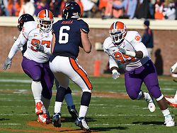 Clemson defensive tackle Dorell Scott (97) and defensive end Drew Traylor (95) put pressure on Virginia quarterback Marc Verica (6).The Clemson Tigers defeated Virginia Cavaliers 13-3 in NCAA Division 1 football at Scott Stadium on the Grounds of the University of Virginia in Charlottesville, VA on November 22, 2008.