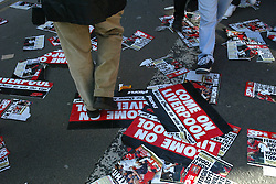 CARDIFF, WALES - Sunday, March 2, 2003: Newspaper posters litter the floor outside the Millennium Stadium before the Football League Cup Final between Liverpool and Manchester United. (Pic by David Rawcliffe/Propaganda)