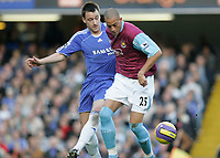 Photo: Marc Atkins.<br />Chelsea v West Ham United. The Barclays Premiership. 18/11/2006. John Terry (L) and Bobby Zamora in action.