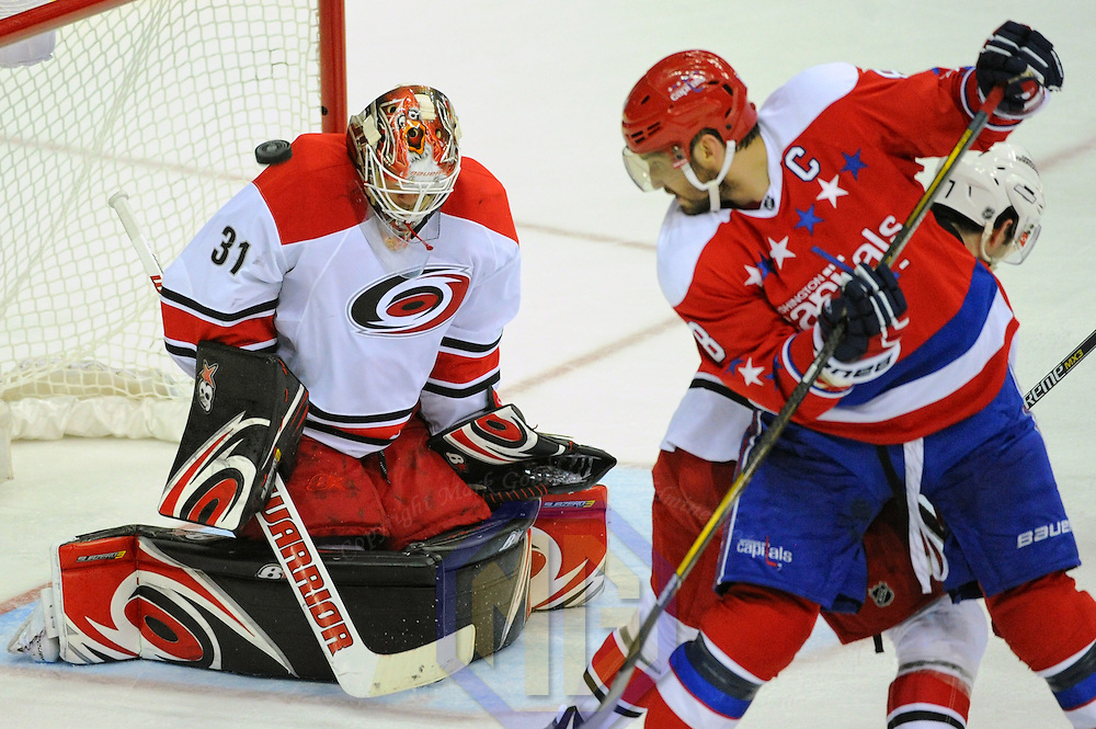 15 March 2016:  Carolina Hurricanes goalie Eddie Lack (31) makes a save on shot by Washington Capitals left wing Alex Ovechkin (8) at the Verizon Center in Washington, D.C. where the Washington Capitals defeated the Carolina Hurricanes, 2-1 in overtime to clinch a playoff spot. (Photograph by Mark Goldman/Icon Sportswire)