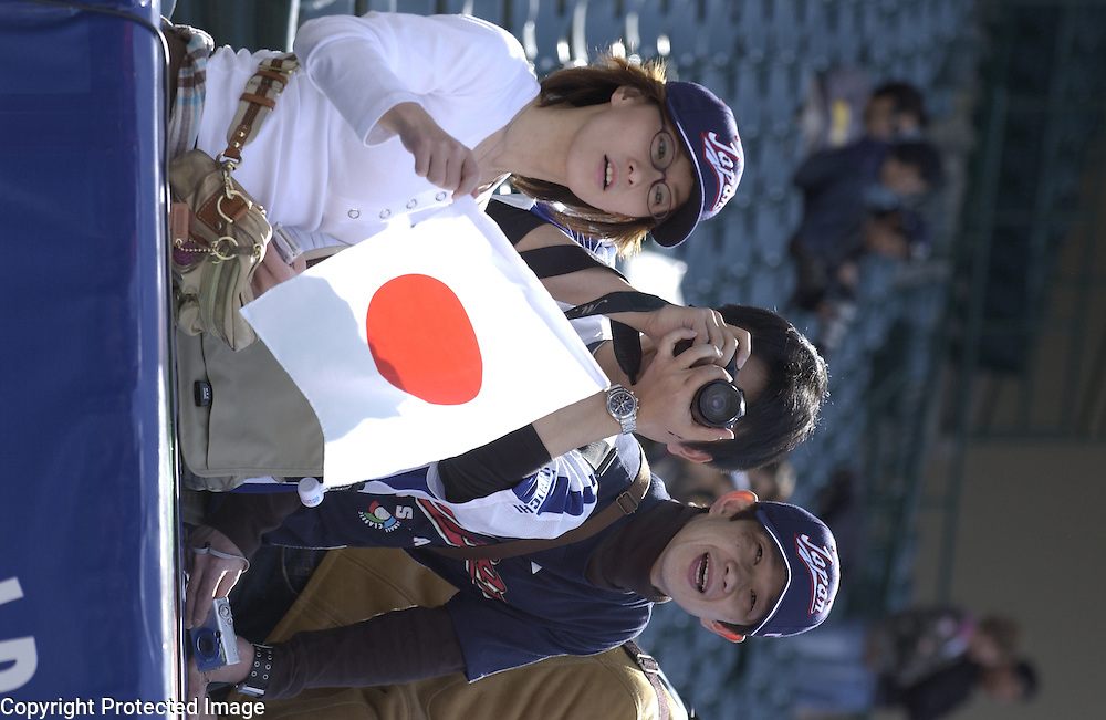 Team Japan fans watch their team warm up before the start of the game against Team Mexico in Round 2 action at Angel Stadium of Anaheim.