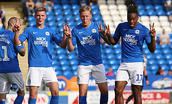 Ivan Toney of Peterborough United (right) celebrates scoring his third goal of the game with team-mates Josh Knight (left) and Frankie Kent (middle) - Mandatory by-line: Joe Dent/JMP - 14/09/2019 - FOOTBALL - Weston Homes Stadium - Peterborough, England - Peterborough United v Rochdale - Sky Bet League One