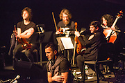 Planetarium, a series of songs composed by Bryce Dessner, Sufjian Stevens, and Nico Muhly at the Brooklyn Academy of Music (BAM). Sufjian Stevens, front, taking a bow.