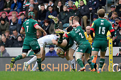 Blaine Scully of Leicester Tigers is upended in the tackle by Marcelo Bosch of Saracens - Photo mandatory by-line: Patrick Khachfe/JMP - Mobile: 07966 386802 16/11/2014 - SPORT - RUGBY UNION - Leicester - Welford Road - Leicester Tigers v Saracens - Aviva Premiership