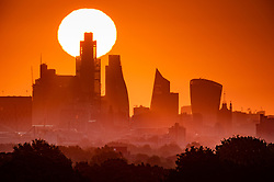 © Licensed to London News Pictures. 06/05/2020. London, UK. The sun rises over the City of London heralding the start of a few days of warm temperatures leading to the May bank holiday weekend. Prime Minister Boris Johnson is expected to announce changes to the lockdown later this week. Photo credit: Peter Macdiarmid/LNP