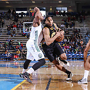 Delaware 87ers Forward Rahlir Hollis-Jefferson (15) drives the lane as Reno Bighorns Guard Ra'shad James (10) defends in the first half of a NBA D-league regular season basketball game between the Delaware 87ers and the Reno Bighorns (Sacramento Kings), Tuesday, Feb. 10, 2015 at The Bob Carpenter Sports Convocation Center in Newark, DEL