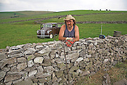 Man building a dry stone wall in the Peak District national park, Derbyshire, England