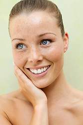 Beauty Portrait of Woman with Hands on Face Smiling