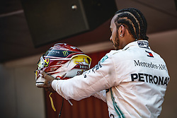 May 12, 2019 - Barcelona, Catalonia, Spain - LEWIS HAMILTON (GBR) from team Mercedes presents his helmet to his teammates after his victory of the Spanish GP presenting his cup on the podium at the Circuit de Barcelona - Catalunya (Credit Image: © Matthias Oesterle/ZUMA Wire)