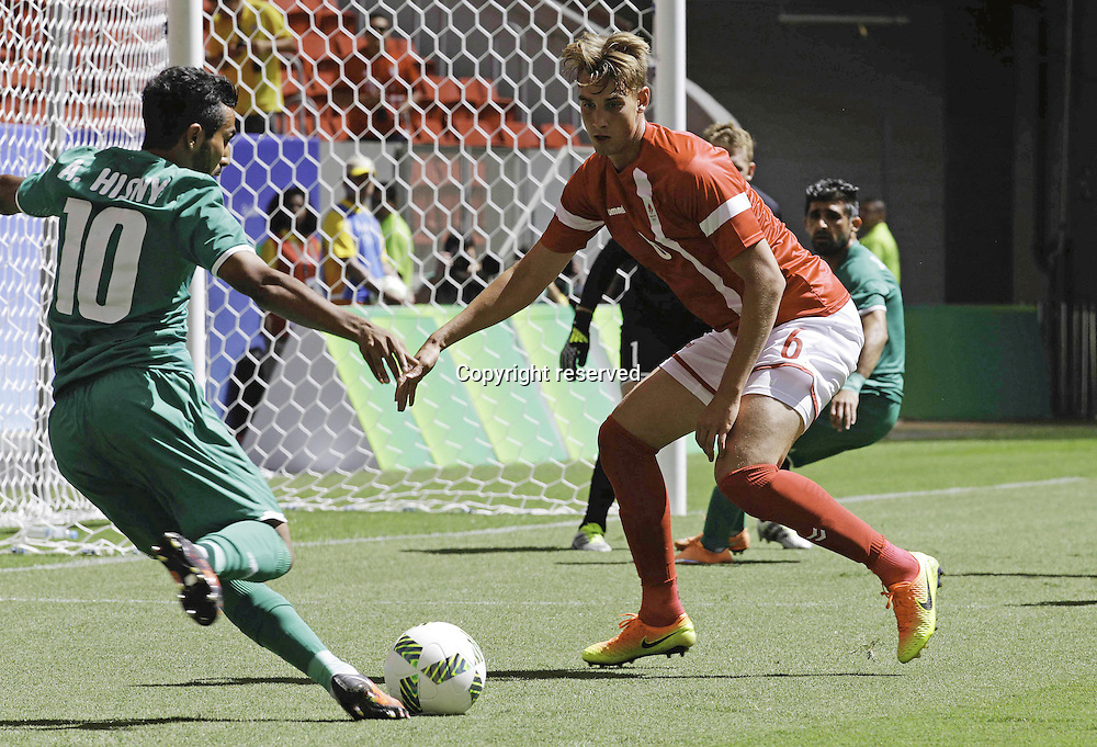 04.08.2016. Brasilia, Brazil. Ali Hinsny Iraq and Andreas Maxso of Denmark during the match between Iraq (IRQ) versus Denmark (DEN), the first game of Football Group A Olympic mens tournament held at the Mané Garrincha Stadium, Brasilia.
