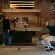 The National Park Service announced the Robie House, the 1910 masterpiece by architect Frank Lloyd Wright built in his classic Prairie Style, has been submitted to UNESCO for World Heritage nomination. Wright built the house for Frederick C. Robie on the campus of the University of Chicago in the neighborhood of Hyde Park in Chicago. Alan Fiesrt takes a picture of Katie Oczkowski, left and Ashley Locke.<br /> Photography by Jose More