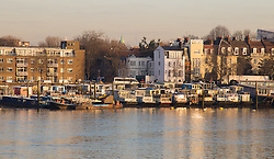 London, February 24th 2016. Houseboats in Chelsea reflect the morning sun as it rises on a chilly but clear morning in London. &copy;Paul Davey<br /> FOR LICENCING CONTACT: Paul Davey +44 (0) 7966 016 296 paul@pauldaveycreative.co.uk