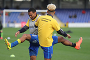 AFC Wimbledon striker Lyle Taylor (33) and AFC Wimbledon defender Darius Charles (32) warming up during the EFL Sky Bet League 1 match between AFC Wimbledon and Plymouth Argyle at the Cherry Red Records Stadium, Kingston, England on 21 October 2017. Photo by Matthew Redman.