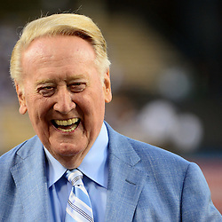 Los Angeles Dodgers announcer Vin Scully smiles as he was honored by the Guinness World Records for the longest career as a sports broadcaster for a single team on his bobble head night prior to a Major League Baseball game between the Arizona Diamondbacks and the Los Angeles Dodgers on Wednesday, Sept. 23, 2015 in Los Angeles.
