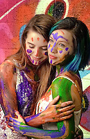Rachel and Olivia paint each other in Art Alley, Kansas City, MO Fine art portrait on film by Kansas City art photographer Kirk Decker.