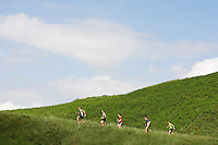 Group jogging up hillside