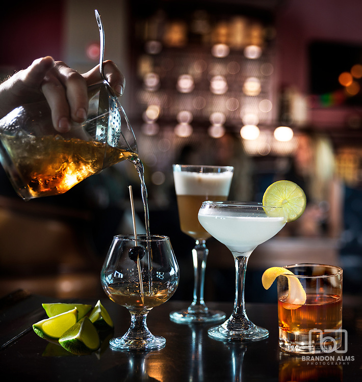 Cocktails being poured at Barley, Wheat, and Rye Social house located in Springfield, MO. Photo by Brandon Alms Photography