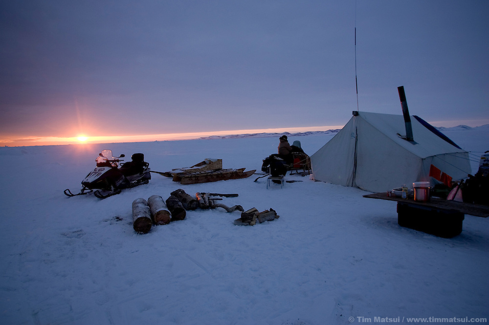 May 3, 2008 -- Kivalina, AK, U.S.A..Austin Swan's whaling camp sits at water's edge on the pack ice, some two miles from shore and 12 miles from the native village of Kivalina, Alaska. Kivalina is suing 20 oil companies for property damage related to global warming; the ocean pack ice forms later and melts earlier, leaving the town vulnerable to erosive winter storms and endangering their traditional subsistence lifestyle. (Photo by Tim Matsui)