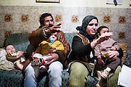 Rosarno, Italia - 19 dicembre 2010. una famiglia di immigrati marocchini all'interno della loro casa. La famiglia è aiutata da alcuni membri della Caritas che forniscono loro beni di prima necessità quando necessari..Ph. Roberto Salomone Ag. Controluce.ITALY - A family of immigrats from Morocco in their house in Drosi on December 19, 2010.
