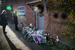 © Licensed to London News Pictures. 26/12/2016. Goring-, UK. Fans of George Michael gather to look at floral tributes placed by his front door. Pop superstar George Michael died on Christmas day at his Oxfordshire home on the River Thames aged 53. Photo credit: Peter Macdiarmid/LNP