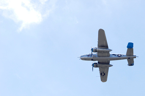 A B-25 bomber, one of a fleet of 20 World War II era aircraft takes part in a fly-over of the National Museum of the U.S. Air Force to commemorate the 70th anniversary of the Dolittle Tokyo Raiders strike into Japan., April 18, 2012.