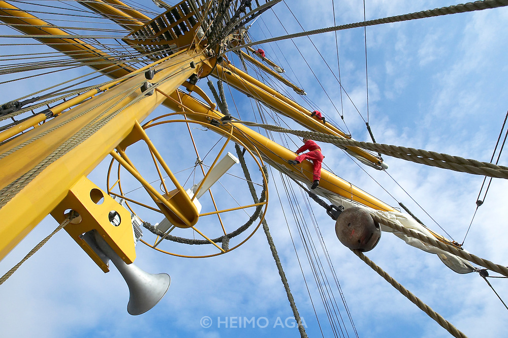 """Riggers and other crew members setting sails aboard the """"Lili Marleen"""" (luxurious sailing ship of Deilmann Cruises)."""