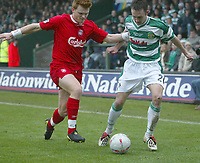 Photo. Andrew Unwin<br /> Yeovil v Liverpool, FA Cup Third Round, Huish Park, Yeovil 04/01/2004.<br /> Liverpools John Arne Riise (l) tussles with Yeovil's Gavin Williams (r).