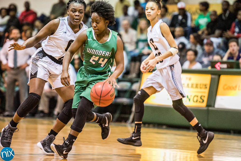 Kannapolis' Jaliah Smoutherson (24) dribbles the ball during a South Piedmont Conference basketball game Saturday night at Central Cabarrus High School.