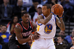 Feb 15, 2012; Oakland, CA, USA; Golden State Warriors shooting guard Monta Ellis (8) is defended by Portland Trail Blazers guard Wesley Matthews (2) during the second quarter at Oracle Arena. Mandatory Credit: Jason O. Watson-US PRESSWIRE