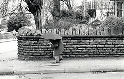 Elderly man with umbrella, Nottingham, UK 1991