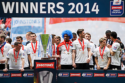 The Peterborough players stand under the winners board after a 3-1 win - Photo mandatory by-line: Rogan Thomson/JMP - 07966 386802 - 30/03/2014 - SPORT - FOOTBALL - Wembley Stadium, London - Chesterfield FC v Peterborough United - Johnstone's Paint Trophy Final.