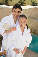 Portrait of couple in bathrobes, outdoors