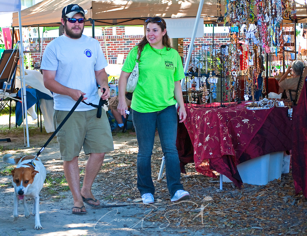 Michael Andres and Jennifer Frey walk their dog, Stanford, as they stroll through an outdoor art market May 8, 2011 at the Mary C. O'Keefe Cultural Center in Ocean Springs. The market is held on the first Saturday of every month from 10 a.m. to 4 p.m. and showcases the wares of local artisans. (Photo by Carmen K. Sisson/Cloudybright)